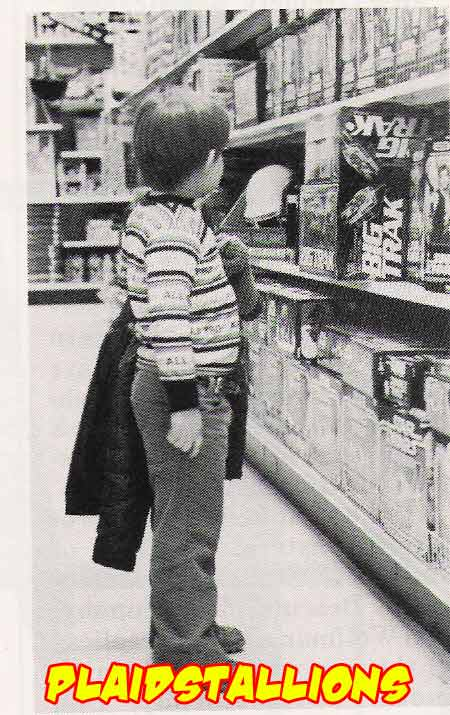a child looking at Kenner Star wars Product in 1980